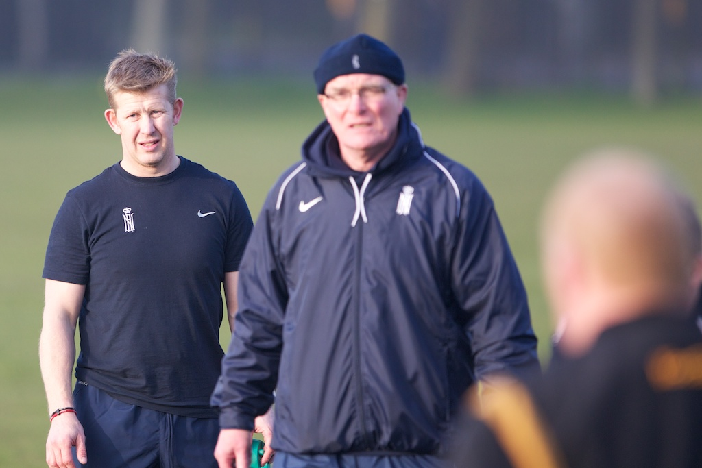 Dave Sibson in the shadow of Mike Connolly at a Mariner's coaching session, 66 years of playing and coaching Navy Rugby between them